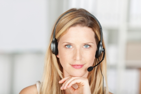customer service phone: smiling woman in call center wearing headset