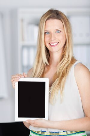 touch pad: business woman shows tablet with copy space