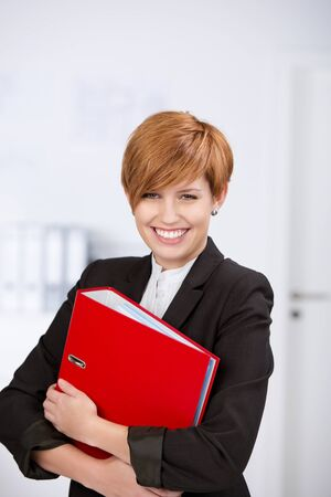 blinder: Portrait of happy confident businesswoman with blinder in office Stock Photo