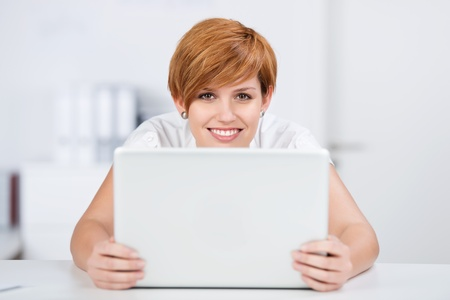 woman short hair: Portrait of happy young businesswoman with digital tablet at desk