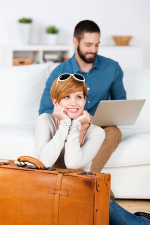 Young happy couple planning a travel with laptop photo