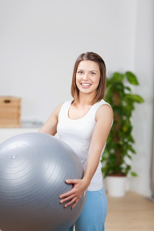 large ball: Woman exercise at home using a fitness ball