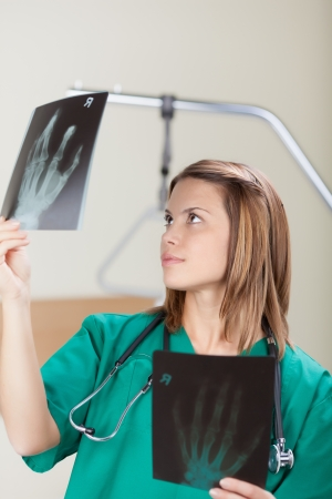 Portrait of a friendly female doctor examining the x-ray image photo