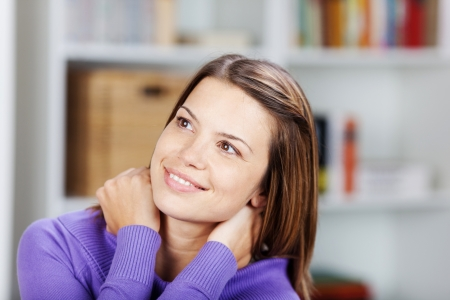 Beautiful female daydreaming while looking at something Stock Photo - 21110758