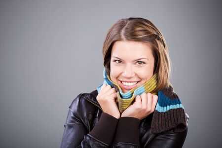 Smiling woman with scarf and jacket isolated on Stock Photo - 21110868