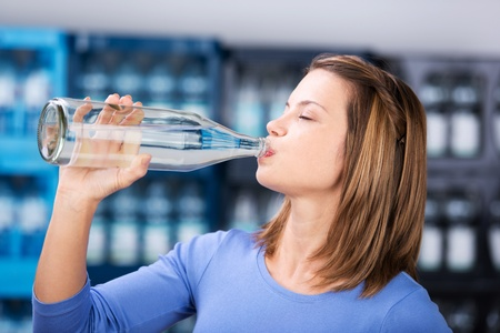 carbonated: Close up portrait of woman drinking water from the bottle Stock Photo