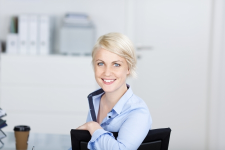 Closeup portrait of a confident and beautiful young businesswoman smiling photo