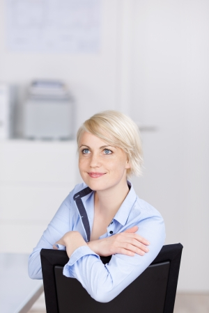 Closeup portrait of a confident and friendly young businesswoman looking up photo