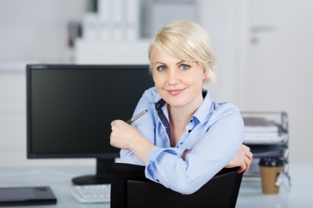 Portrait of a confident and beautiful young businesswoman looking at camera Stock Photo