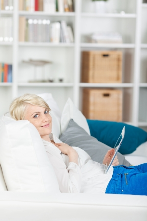 portrait of a blond girl with digital pad at home Stock Photo - 21111458
