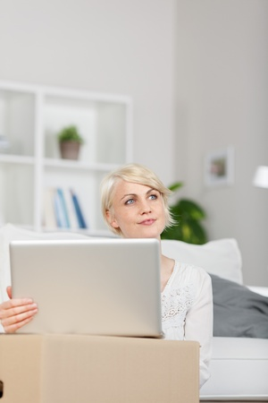 young woman with cardboard boxes and laptop Stock Photo - 21111655