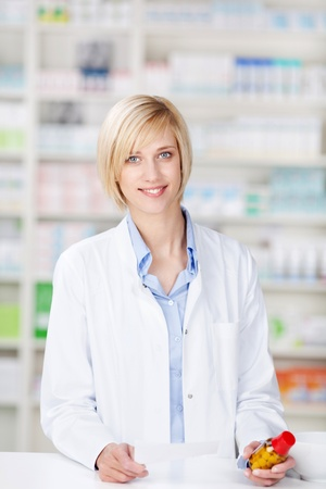 portrait of a smiling female pharmacist standing at the counter Stock Photo - 21112232