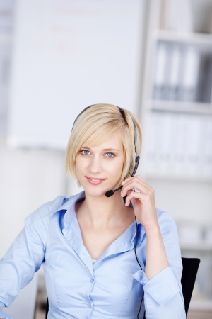 costumer: smiling costumer support executive with headset in office Stock Photo