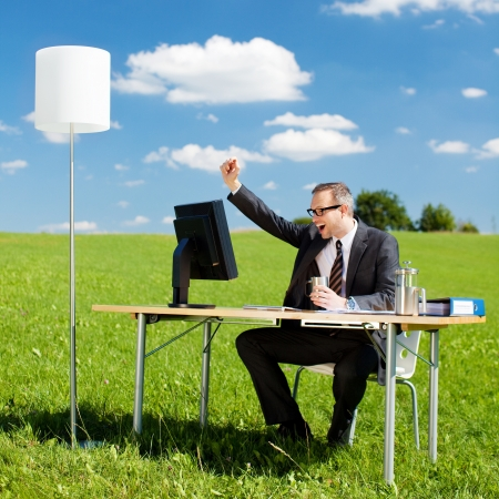 jubilation: Successful businessman raising his hand in the office outdoors Stock Photo