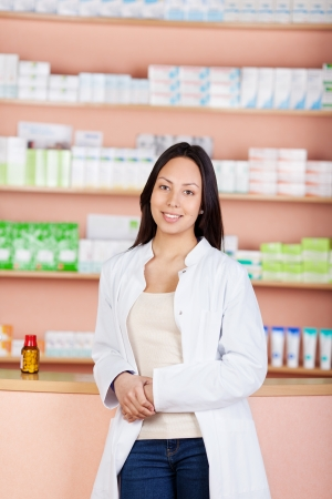 smiling young female woman working in pharmacy photo