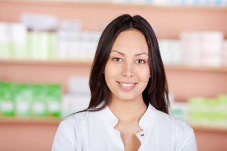 portrait of a beautiful young woman working in pharmacy photo