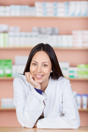 smiling young asian woman working in pharmacy photo