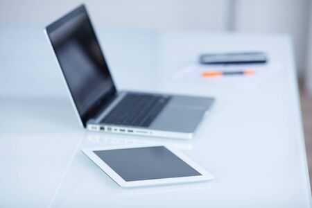 Laptop and tablet-pc lying on an office workspace conceptual of modern mobile technology photo
