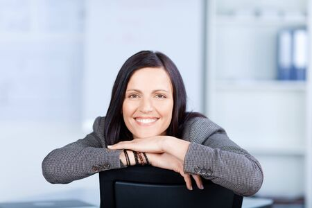 Cheerful businesswoman smiling in a front view shot photo