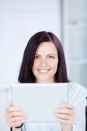 Woman browsing the internet using her ipad touch photo