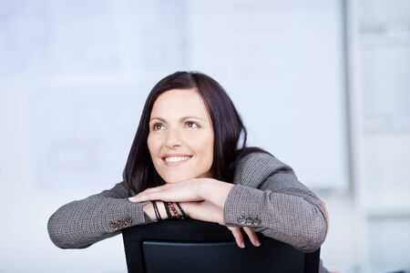arms on chair: Close up portrait of businesswoman in a looking up gesture