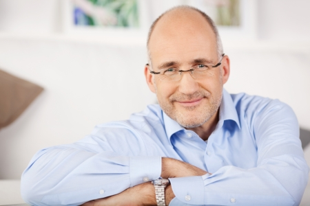man with glasses: Close portrait of smiling man relaxing at home Stock Photo