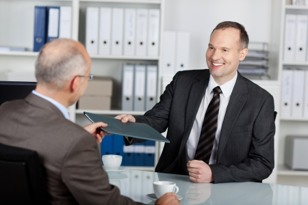 applicant: Portrait of a manager interviewing a male applicant in his office Stock Photo