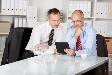 businesspersons: Two businesspersons looking at the tablet computer inside the office Stock Photo