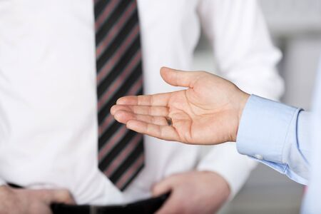 unrecognisable person: Close up gesture of hand discussing something at the office