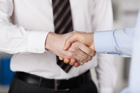 Close up gesture of two businessmen shaking hands photo