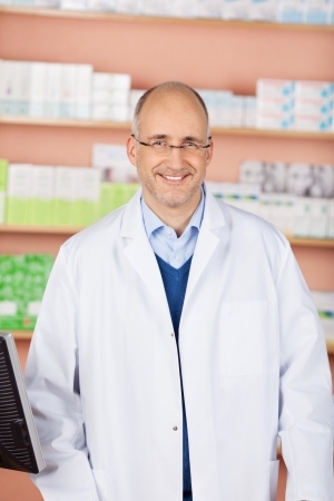 Portrait of handsome friendly pharmacist in his shop Stock Photo - 21146980