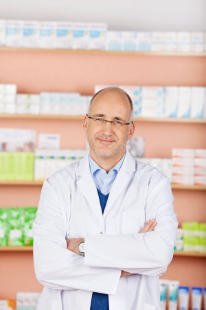 Portrait of bald friendly pharmacist in his shop photo