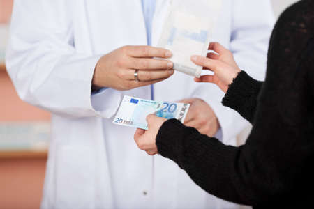 20 euro: Unrecognized woman buying 20 Euro for a medicine