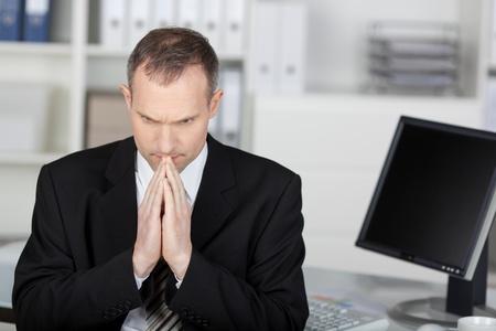 Portrait of worried businessman inside the office photo
