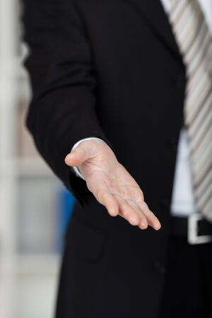 Conceptual gesture of business hand receiving something photo