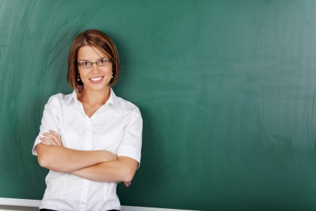 crossed: Portrait of teacher with glasses posing with arms crossed