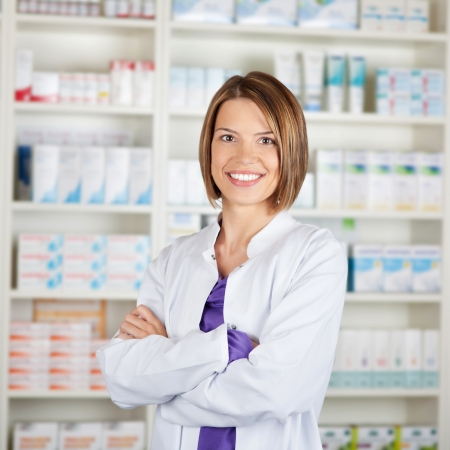 Portrait of a smiling medical personnel or doctor in pharmacy photo