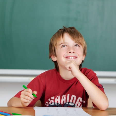 daydreaming: Smiling student while thinking to solve a problem
