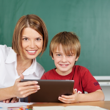 Teacher and student during lesson with tablet photo