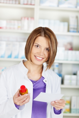 Smiling pharmacist chemist woman working in pharmacy drugstore photo
