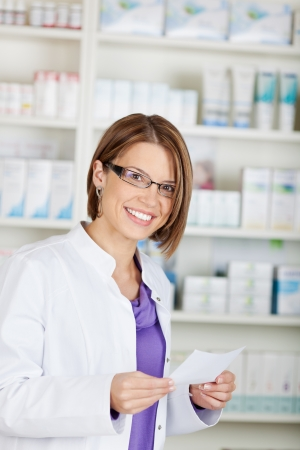 Smiling pharmacist chemist woman with prescription in pharmacy drugstore Stock Photo - 21148559