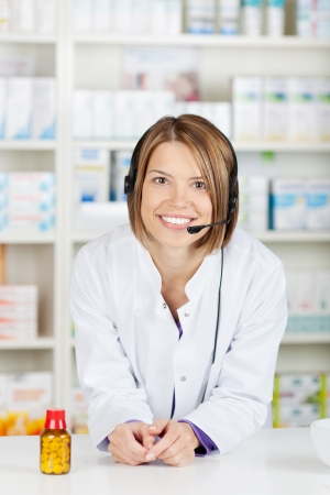 Portrait of young Woman pharmacist in drug store Pharmacy photo