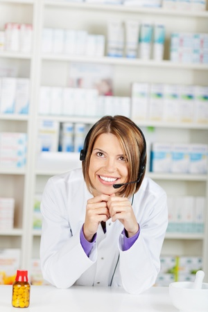 Portrait of beautiful woman pharmacist in drugstore Pharmacy photo