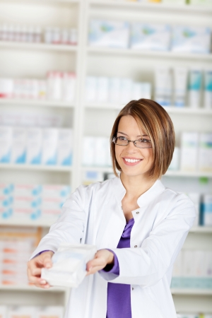 The pharmacist sells the medicine in a pharmacy drugstore Stock Photo - 21148581