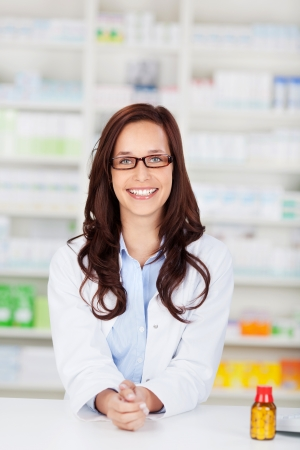 Happy cheerful pharmacist chemist woman standing in pharmacy drugstore Stock Photo - 21148751