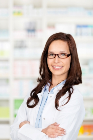 Portrait of a confident female pharmacist standing in drugstore photo