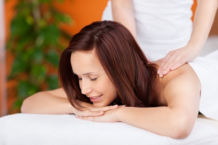 body massage: Beautiful relaxing woman having a massage in spa