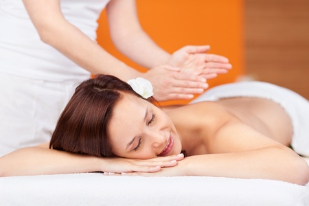Attractive female is getting a relaxing back massage photo