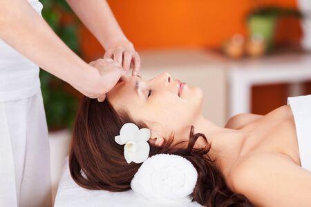 eyesclosed: Relaxing fresh woman having facial massage in spa