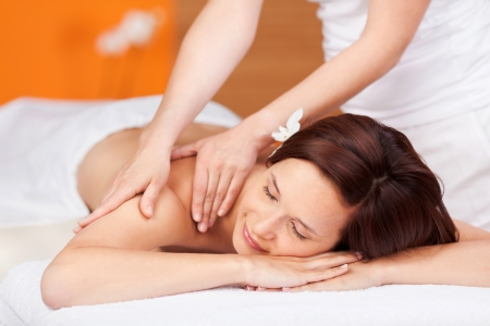 Young woman enjoys a relaxing massage at spa Stock Photo - 21149022